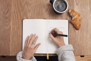 Writing in a note pad